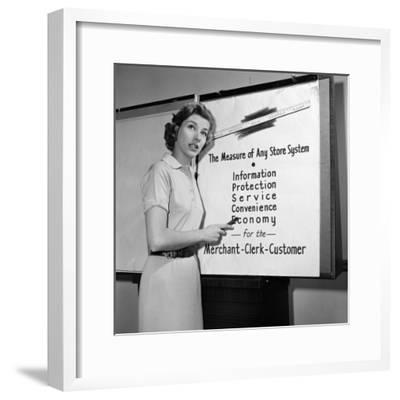 Young Career Woman Giving Business Presentation, Pointing at Poster-H. Armstrong Roberts-Framed Photographic Print