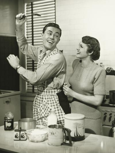 Young Cheerful Couple in Kitchen, Man in Apron-George Marks-Photographic Print