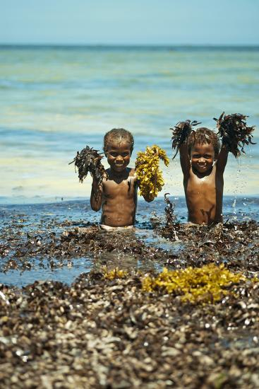 Young Children Playing with Seaweed, Ifaty, Tulear, Madagascar-Anthony Asael-Photographic Print