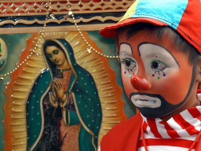 """Young Clown, """"Bolillito,"""" Stands Next to an Image of the Virgin of Guadalupe in Mexico City--Photographic Print"""