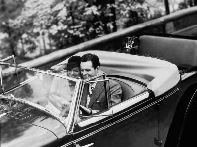 Young Couple in Vintage Soft Top Car With Golf Clubs on Back Seat--Photographic Print