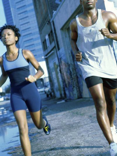 Young Couple Jogging Together--Photographic Print