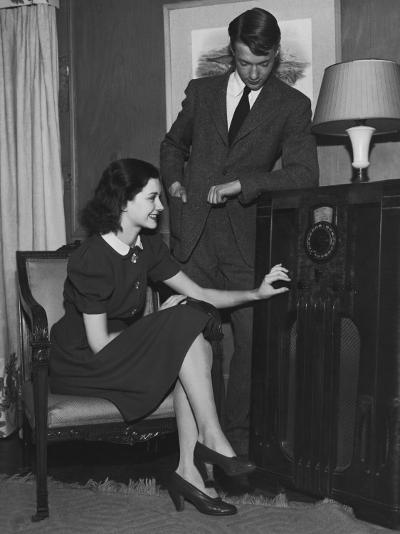 Young Couple Listening To Radio--Photographic Print