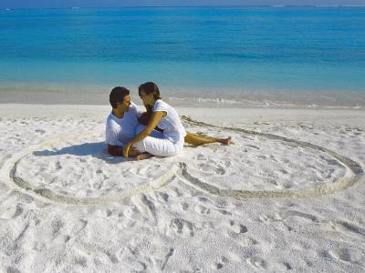 Young Couple on Beach Sitting in a Heart Shaped Imprint on the Sand, Maldives, Indian Ocean, Asia-Sakis Papadopoulos-Photographic Print