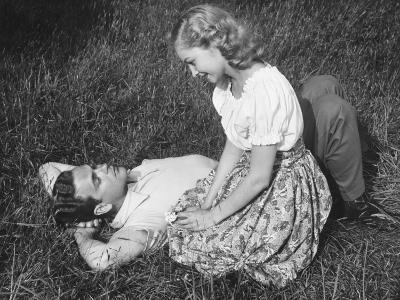 Young Couple Resting on Lawn-George Marks-Photographic Print