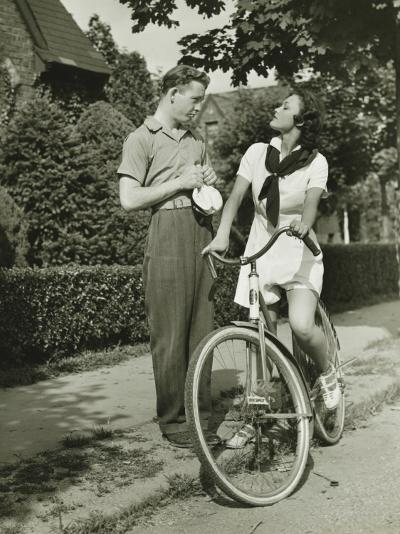 Young Couple Talking on Street, Woman on Bicycle-George Marks-Photographic Print