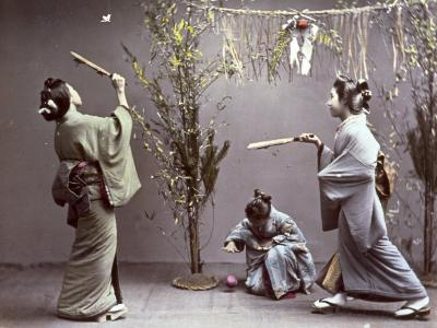 Young Geishas in Traditional Costume Playing 'Hanetuki'--Photographic Print