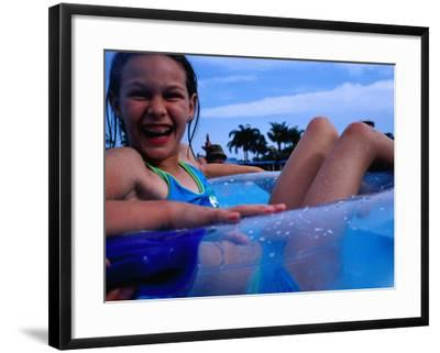 Young Girl Floating in Swimming Pool in Rubber Ring, Gold Coast, Australia-Richard I'Anson-Framed Photographic Print