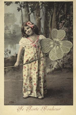 Young Girl Holding Giant Four-Leaf Clover--Photographic Print