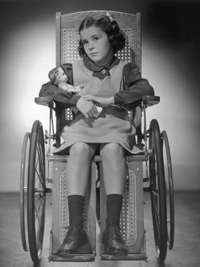 Young Girl in Her Wheelchair W/Her Doll-George Marks-Photographic Print