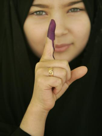 https://imgc.artprintimages.com/img/print/young-girl-shows-her-inked-finger-even-though-she-was-too-young-to-vote-in-karbala-iraq_u-l-q10oqd30.jpg?p=0