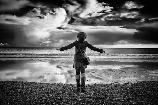 Young Girl Standing on a Beach-Rory Garforth-Photographic Print