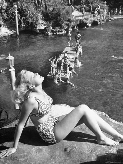 Young Girl Sunbathing at the Venetian Pool-Allan Grant-Photographic Print