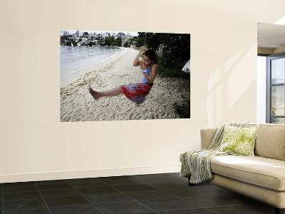 Young Girl Swinging on a Rope, Seven Shillings Beach-Oliver Strewe-Wall Mural