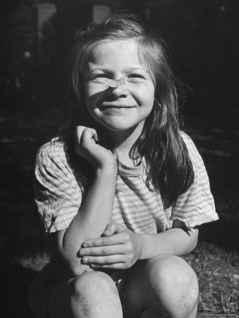 https://imgc.artprintimages.com/img/print/young-girl-with-long-hair-and-raggedy-shirt-smiling-wearing-seed-pod-on-nose_u-l-p3p21u0.jpg?artPerspective=n