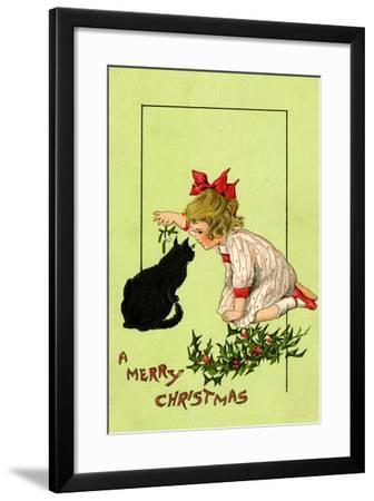Young Girl with Red Bow and Shoes Holding Mistletoe Over a Black Cat, Beatrice Litzinger Collection--Framed Art Print