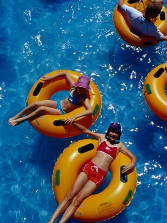 https://imgc.artprintimages.com/img/print/young-girls-floating-in-rubber-rings-in-swimming-pool_u-l-pd7e9t0.jpg?p=0