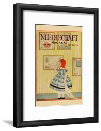 Young Girls Looks At a Selection of Old Needlepoints On a Wall
