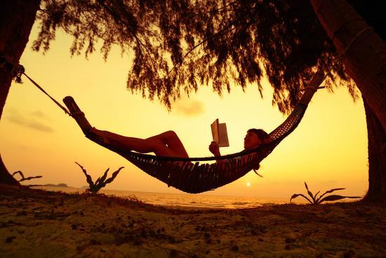 Young Lady Reading the Book in the Hammock on Tropical Beach at Sunset-Dudarev Mikhail-Photographic Print