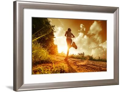 Young Lady Running on a Rural Road during Sunset-Dudarev Mikhail-Framed Photographic Print