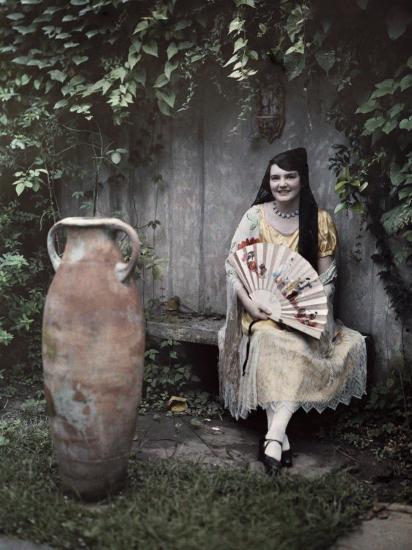 Young Lady Sits on a Bench by a Vase in a French Quarter Garden-Edwin L^ Wisherd-Photographic Print