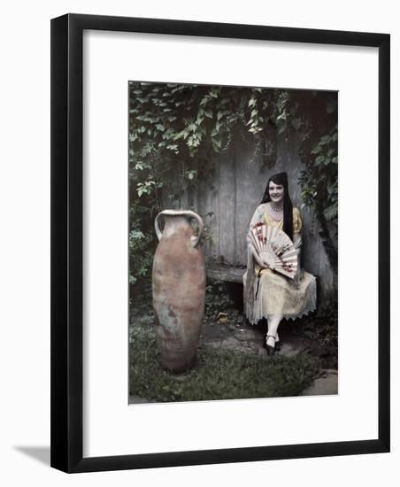 Young Lady Sits on a Bench by a Vase in a French Quarter Garden-Edwin L. Wisherd-Framed Photographic Print