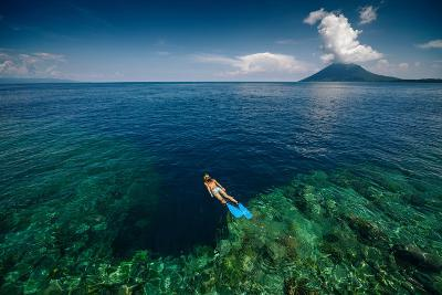 Young Lady Snorkeling over the Reef Wall in the Area of the Island of Bunaken, Sulawesi, Indonesia-Dudarev Mikhail-Photographic Print