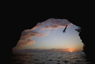 Young Man Diving into Sea at Pirate's Cave-Paul Souders-Photographic Print