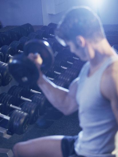Young Man Exercising with Dumbbells--Photographic Print