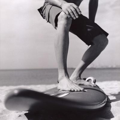 https://imgc.artprintimages.com/img/print/young-man-standing-on-surfboard-on-the-beach_u-l-pzkpc10.jpg?p=0