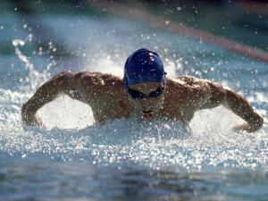 Young Man Swimming the Butterfly Stroke
