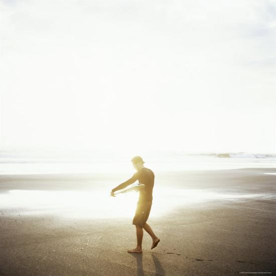 Young Man Waxes His Board Before Entering Marabella's Waves, Costa Rica, Central America-Aaron McCoy-Photographic Print