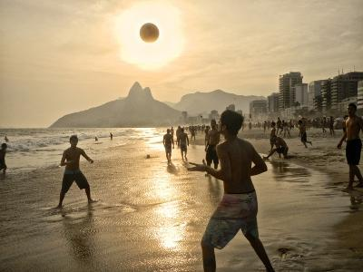 Young Men Play Beach Football on Ipanema Beach as the Sun Sets-Kike Calvo-Premium Photographic Print