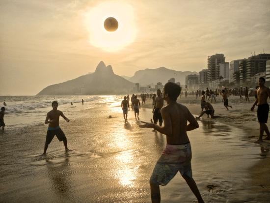 Young Men Play Beach Football on Ipanema Beach as the Sun Sets-Kike Calvo-Photographic Print