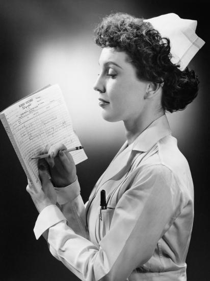Young Nurse Writing on File in Studio-George Marks-Photographic Print