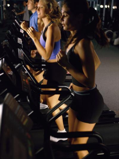Young People Running on Treadmills in a Gym--Photographic Print