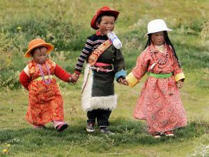 Young Tibetan Children Walk Hand in Hand Near Qinghai Lake