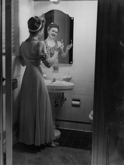 Young Woman Brushing Teeth in Bathroom-George Marks-Photographic Print