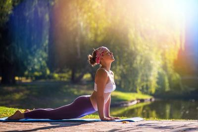 https://imgc.artprintimages.com/img/print/young-woman-doing-yoga-in-morning-park_u-l-q1bvar60.jpg?p=0