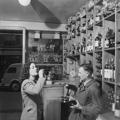 Young Woman Drinking a Bottle of Coca Cola in a Shop, Paris, France, 1950-Mark Kauffman-Photographic Print