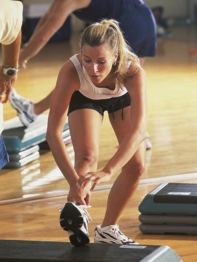 Young Woman Exercising in a Step Aerobics Class--Photographic Print