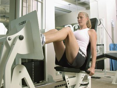 Young Woman Exercising on a Machine in a Gym--Photographic Print