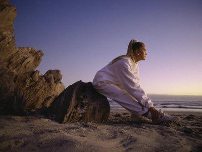 https://imgc.artprintimages.com/img/print/young-woman-exercising-on-the-beach_u-l-q10s54f0.jpg?p=0