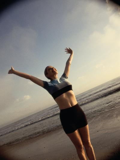 Young Woman Exercising on the Beach--Photographic Print