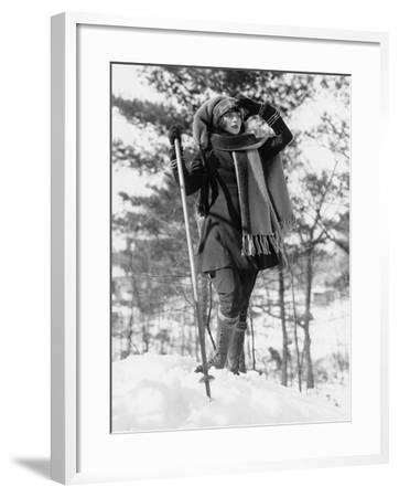 Young Woman Hikes Through Snow Covered Woods--Framed Photo