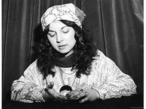 Young Woman Holds and Interprets a Crystal Ball