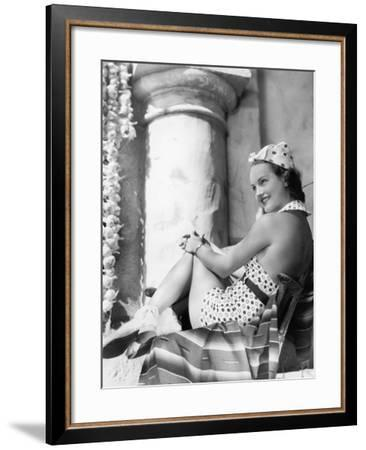 Young Woman in a Sun Suit Sitting on a Chair--Framed Photo
