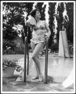 Young Woman in an Abstract Print Bikini with Broderie Anglaise Trim Towel Dries Her Hair