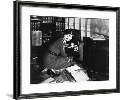Young Woman in an Office Next to a Safe, Looking over Her Shoulder--Framed Photo