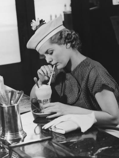 Young Woman in Fancy Hat Drinking Ice Cream Soda-George Marks-Photographic Print